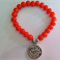 Orange and Silver coin glass bracelet