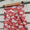 Size 3-4yrs skirt in Organic cotton clouds and swallows on red background