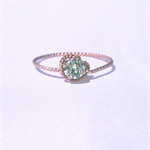Gold knot ring with pale green Swarovski crystal