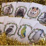 bundle of 8 Australian Christmas cards - wildlife in a gum leaf wreath