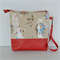 Waterproof vinyl toiletry bag. Red vinyl with PVC covered cotton.