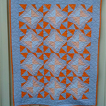 Handmade cot sized patchwork quilt