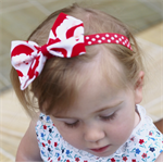 Santa handmade bow on polka dot Stretch Headband.