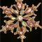 Gold metallic cotton stiffened christmas snowflake embellished with pink stones