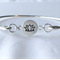 Sterling silver bangle with lotus flower charm