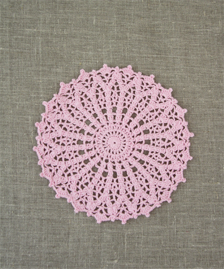 Crochet doily, large in ferry floss pink, free postage