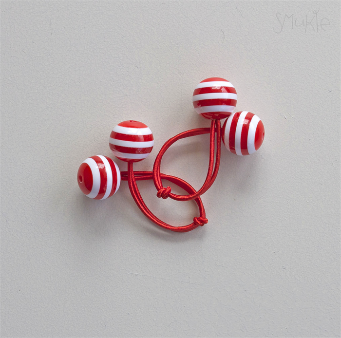 Hair ties. Elastic hair ties. Funky. Red and white stripes. Retro style.  7a80ba60089