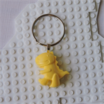 DINO-TASTIC - Tyrannosaurus Rex dinosaur bag tag hand cast in yellow resin