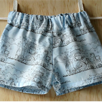 Infant boys cute baby blue patterned shorts.