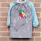 Art smock for 5 - 8 year old. Soccer, green checked sleeves and back.