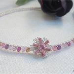 Swarovski crystal hairband with flower in shades of pink/purple