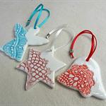 Porcelain Christmas decorations. Bell, Angel, Star. Ceramic ornaments.