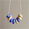 gold glitter royal blue polymer clay bead adjustable tan leather string necklace