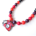 Ring Ring orange, red and purple Necklace by Sasha + Max