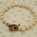 ~ VINTAGE PEACH PEARL~  bracelet hand knotted on silk & bamboo copper toggle