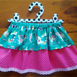 The 'Lacey-Bug Layered Skirt' sizes 1-5, green toys/pink spot