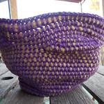 Crocheted bowl in purple and mustard yarn
