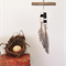 WALL HANGING boho wood branch with black and white feathers and clay beads