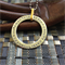 'Umbriel' Free flowing 38mm Silver washer with gold bail pendant