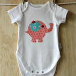 Toddler girls onesie with elephant applique.