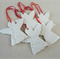 Porcelain Christmas decorations. White with red ribbon. Ceramic. Ornaments.