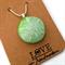 Lisa Wong-Kam Designs, green sand dollar dichroic glass pendant