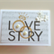 Love story with music notes, gold rings & paper flowers and pearls card
