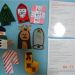 8 pack of Christmas felt puppets with 10 songs on a laminated card