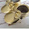 Metallic Gold bow moccasins