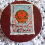 Brooch handcrafted from reclaimed hardwood and Vietnamese postage stamp.
