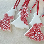 Porcelain Christmas tree decorations. Red and white. Ceramic Ornaments.