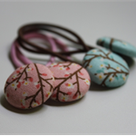 Two pairs of fabric covered button hair elastics cherry blossom pink and aqua