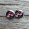 Glass dome stud earrings - pink flamingos on black