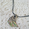 Unusual Paua Shell pendant with organic decorative work on black cord