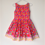 Girls dress size 7 elegant pleated multi spot on fuschia with chevrons.