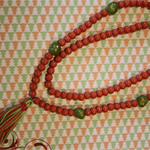 Tangerine, tasseled beaded necklace