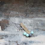 Egg shell blue  and grey polymer clay Necklace