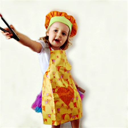 Child's apron and chef hat - Yellow trees on an orange background