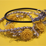Trio of yellow and silver bracelets