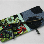 Patchwork quilted eyeglass case featuring Tula Pink Moon Shine fabric