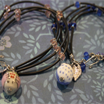 Two cute owl bracelets, one pink, one blue