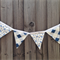 Blue and white forensic fingerprints and checkered  fabric bunting with 13 flags