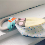 Cotton fabric and wood teething ring with polka dot print