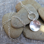 PATTERNS, STERLING SILVER ROLLER PRINTED CHARM NECKLACE