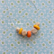 Orange and Yellow polymer clay necklace with faceted geometric wooden beads