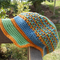crocheted cap made from cotton/acrylic yarns orange, blue and green