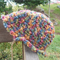 crocheted cloche made from pure wool.  Blue, green, orange, yellow and pink