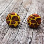 Giraffe print polymer clay stud earrings.