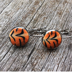 Tiger print polymer clay dangle earrings.