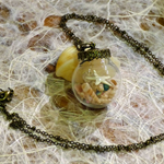 Keep the beach close to your heart - Glass pendant with ocean collectables